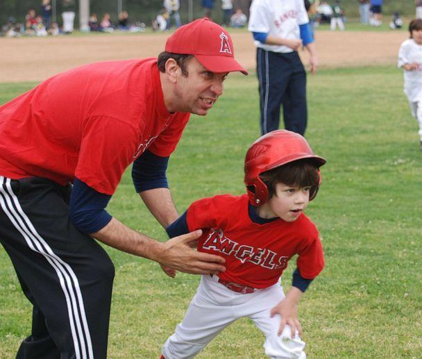 PHOTO: MOJO founder and CEO Ben Sherwood with his son playing little league baseball. (MOJO)