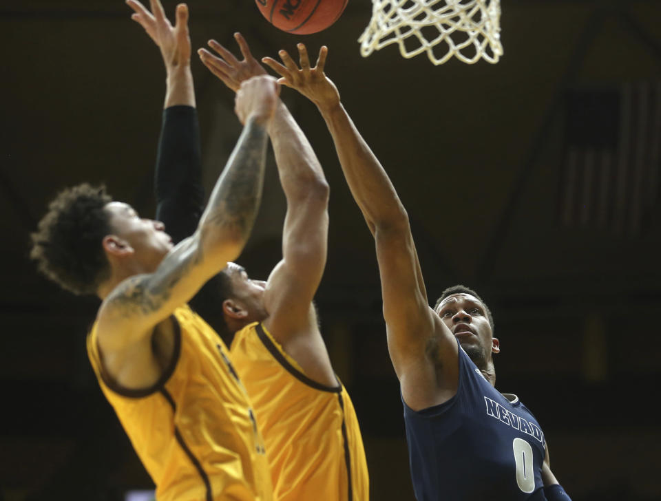Nevada forward Tre'Shawn Thurman (0) shoots during the first half of an NCAA college basketball game against Wyoming on Saturday, Feb. 16, 2019, in Laramie, Wyo. (AP Photo/Jacob Byk)