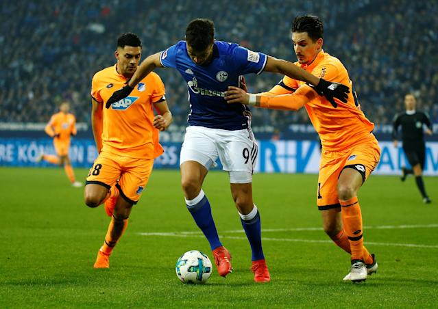 Soccer Football - Bundesliga - Schalke 04 vs TSG 1899 Hoffenheim - Veltins-Arena, Gelsenkirchen, Germany - February 17, 2018 Schalke's Franco Di Santo in action with Hoffenheim's Nadiem Amiri and Benjamin Hubner REUTERS/Leon Kuegeler DFL RULES TO LIMIT THE ONLINE USAGE DURING MATCH TIME TO 15 PICTURES PER GAME. IMAGE SEQUENCES TO SIMULATE VIDEO IS NOT ALLOWED AT ANY TIME. FOR FURTHER QUERIES PLEASE CONTACT DFL DIRECTLY AT + 49 69 650050