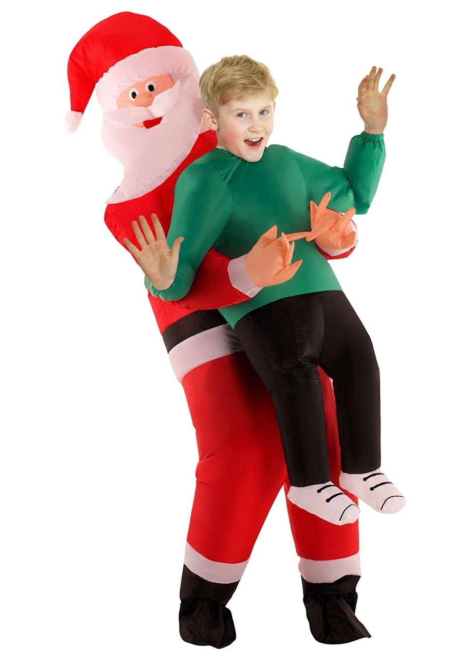 """Dressing up as Santa is a tradition for many people, but this costume allows you to be <a href=""""https://www.halloweencostumes.com/kids-santa-pick-me-up-costume.html"""" target=""""_blank"""" rel=""""noopener noreferrer"""">Santa as well as somebody who has to deal with him awkwardly invading your personal space.</a>Progress!"""