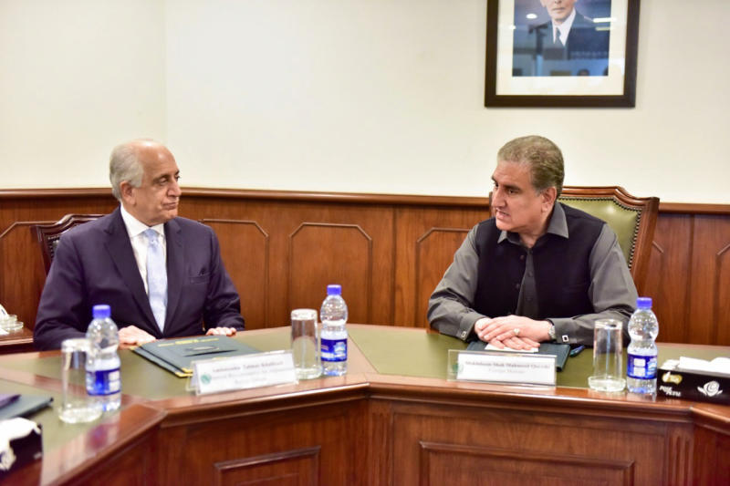 In this photo released by the Foreign Office, Pakistan's Foreign Minister Shah Mehmood Qureshi, right, meets U.S. envoy Zalmay Khalilzad at the Foreign Ministry in Islamabad, Pakistan, Friday, Jan. 31, 2020. Khalilzad has met with Pakistan's foreign minister to find a peaceful solution to neighboring Afghanistan's war. (Pakistan Foreign Office via AP)