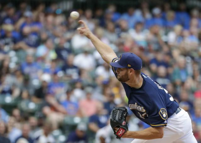 Milwaukee Brewers starting pitcher Adrian Houser throws during the first inning of a baseball game against the Texas Rangers Saturday, Aug. 10, 2019, in Milwaukee. (AP Photo/Morry Gash)