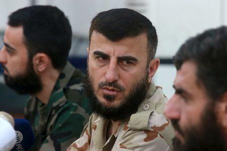 Zahran Alloush (C), commander of Jaysh al Islam, talks during a conference in the town of Douma, eastern Ghouta in Damascus, Syria August 27, 2014. REUTERS/Bassam Khabieh/Files