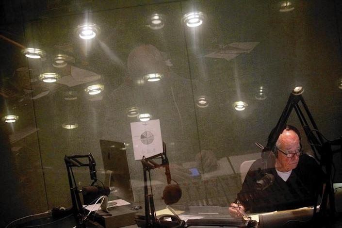 "Warren Olney hosts ""Which Way, L.A.?"" from the basement studio at KCRW at Santa Monica College. <span class=""copyright"">(Genaro Molina / Los Angeles Times)</span>"