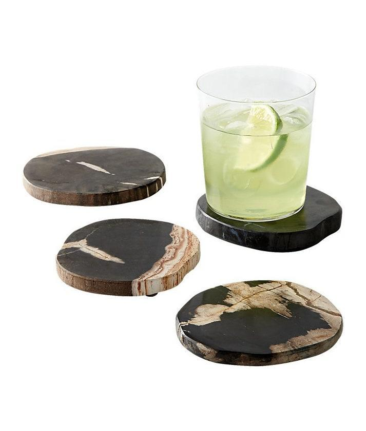 """If your friend just moved into their first """"adult"""" space, they likely need some coasters. Crafted from petrified wood derived from ancient Indonesian tropical forests, this unique set is practical and stylish. $50, CB2. <a href=""""https://www.cb2.com/ring-petrified-wood-coasters-set-of-4/s211804"""" rel=""""nofollow noopener"""" target=""""_blank"""" data-ylk=""""slk:Get it now!"""" class=""""link rapid-noclick-resp"""">Get it now!</a>"""