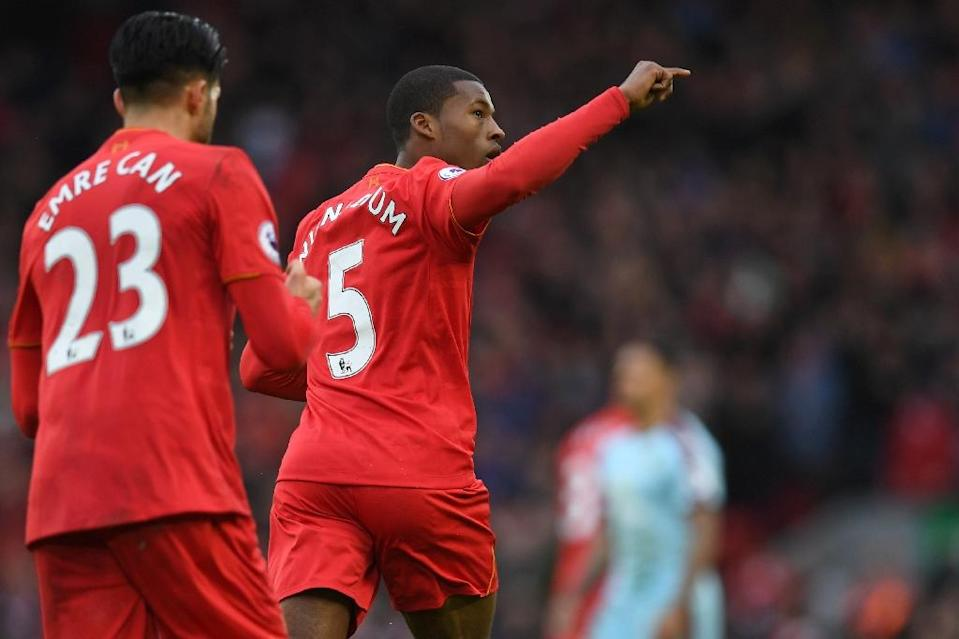 Having won three of their last four games, Liverpool have opened up a five-point gap on fifth placed Arsenal as the race for Champions League qualification hots up (AFP Photo/Paul ELLIS)