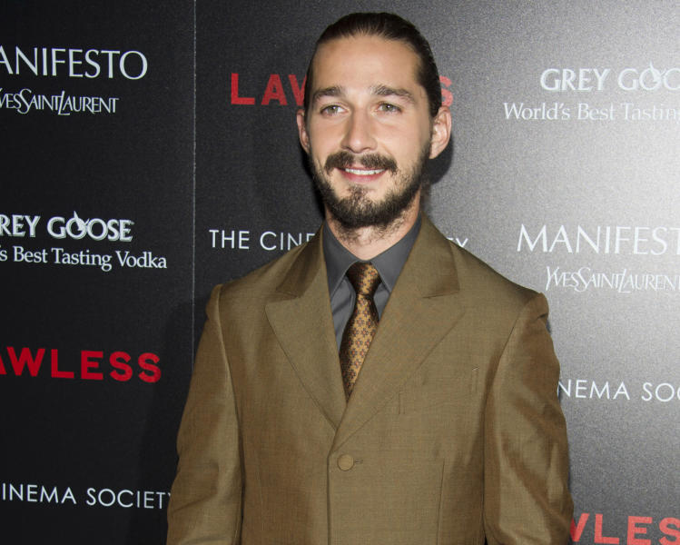 "FILE - In this Aug. 13, 2012 file photo, Shia LaBeouf attends a screening of ""Lawless"" hosted by The Weinstein Company and The Cinema Society in New York. LaBeouf appears completely nude in Sigur Rós' new music video in Lars Von Trier's ""The Nymphomaniac."" LaBeouf can next be seen in ""Lawless,"" opening Wednesday, about a West Virginia moonshine business during the Prohibition era. (Photo by Charles Sykes/Invision/AP, File)"