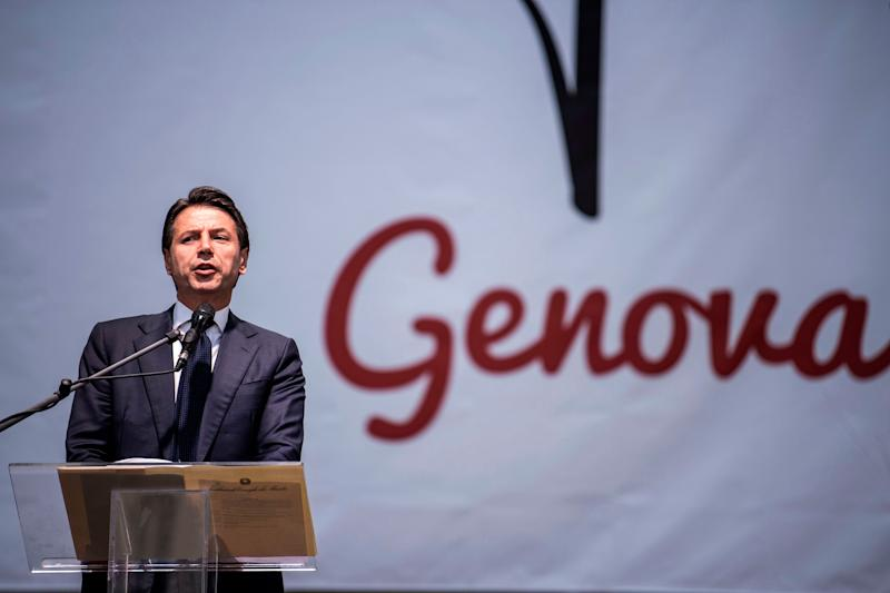 Italy's prime minister Giuseppe Conte delivers a speech during a commemoration ceremony one month after the Morandi Bridge collapse that killed 43 people, on September 14, 2018 on Piazza De Ferrari in Genoa. - A month after Genoa's Morandi Bridge collapse killed 43 people, the port city is tending to its wounds and those left homeless by the disaster are turning a brave face to the future. (Photo by MARCO BERTORELLO / AFP) (Photo credit should read MARCO BERTORELLO/AFP via Getty Images) (Photo: MARCO BERTORELLO via Getty Images)