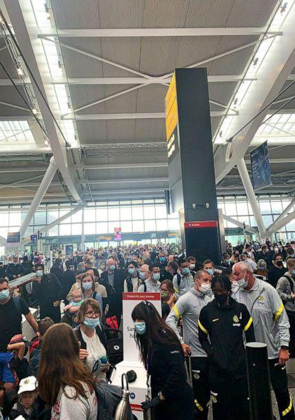 PHOTO: Passengers at Heathrow faced long queues on July 12, 2021 due to security staff being told to self-isolate, the airport said. (@KTWylie/Kathryn Wylie/PA Wire via ZUMA Press)