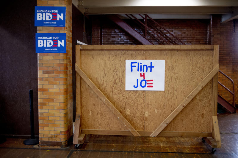 Signs in support of former Vice President Joe Biden are taped to the walls at Berston Field House after his campaign stop on Monday, March 9, 2020 in Flint. Biden is a candidate for the Democratic nomination for president. (Jake May/The Flint Journal via AP)