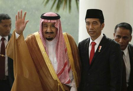 Saudi Arabia's King Salman waves as he stands next to Indonesian President Joko Widodo during their meeting at the Presidential Palace in Bogor, West Java, Indonesia Wednesday, March 1, 2017. REUTERS/Achmad Ibrahim/Pool