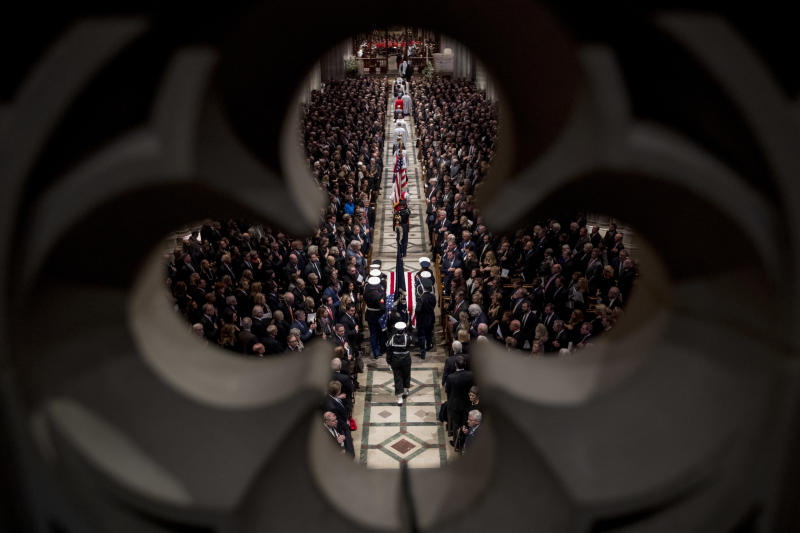 The flag-draped casket of former President George H.W. Bush is carried by a military honor guard into a State Funeral at the National Cathedral. (ASSOCIATED PRESS)
