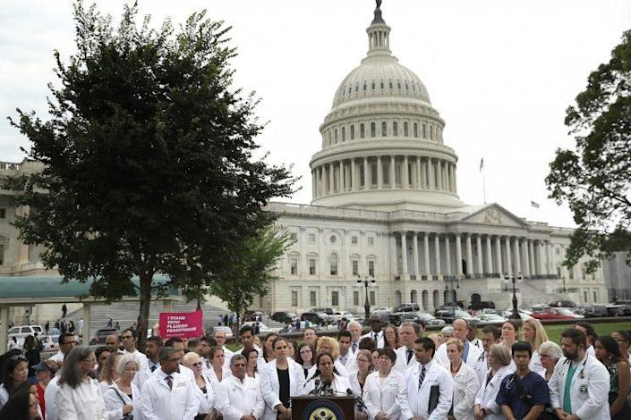 Health care providers hold a news conference outside the U.S. Capitol.