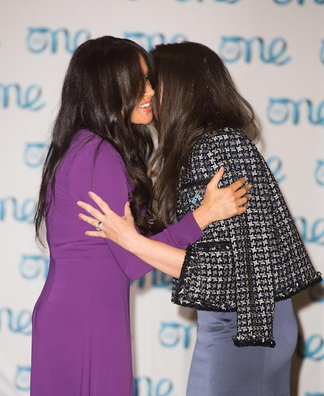 Meghan, Duchess of Sussex hugs One Young World's managing director Ella Robertson at the One Young World Summit Opening Ceremony at Royal Albert Hall on October 22, 2019 in London, England. [Photo: Getty]