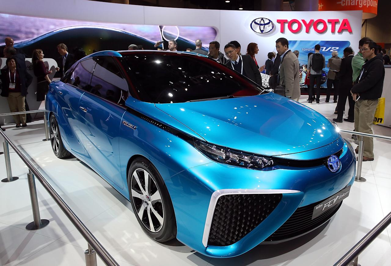 LAS VEGAS, NV - JANUARY 07: Attendees look at the Toyota FCV fuel cell vehicle concept car at the Toyota booth at the 2014 International CES at the Las Vegas Convention Center on January 7, 2014 in Las Vegas, Nevada. CES, the world's largest annual consumer technology trade show, runs through January 10 and is expected to feature 3,200 exhibitors showing off their latest products and services to about 150,000 attendees. (Photo by Justin Sullivan/Getty Images)