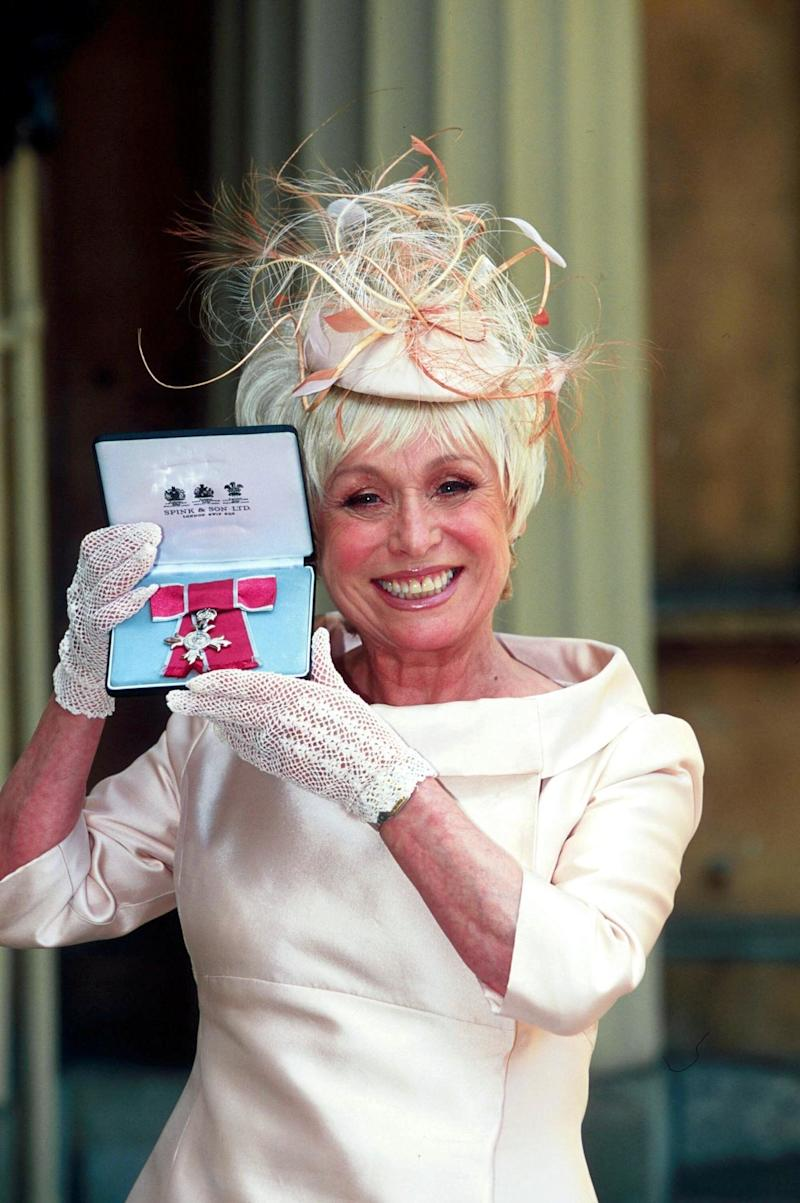 Receiving her MBE at Buckingham Palace in 2000.