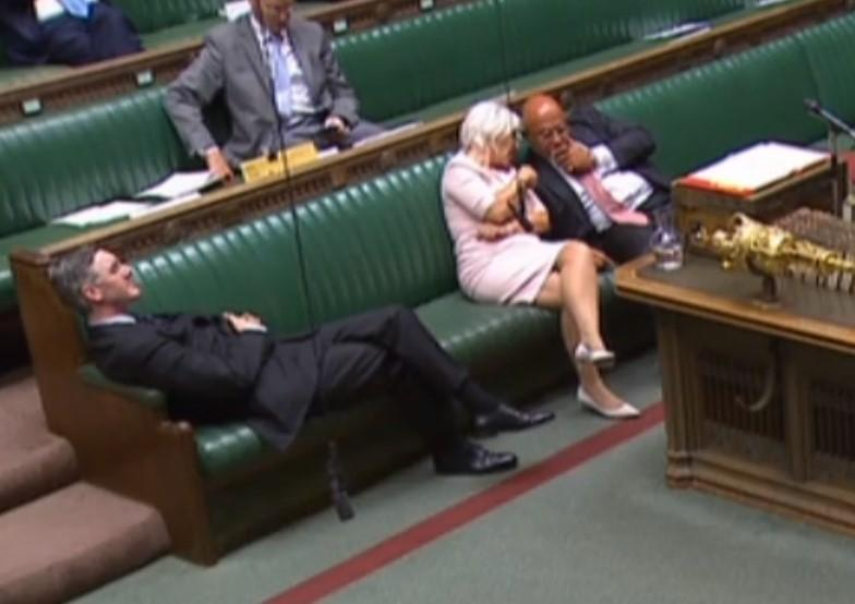 Leader of the House of Commons Jacob Rees-Mogg reclining on his seat in the House of Commons London.