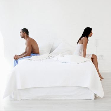 Couple-on-opposite-ends-of-bed_web