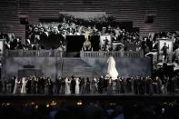 A view of the stage during 'Cavalleria Rusticana' lyric opera, at the Arena di Verona theatre, in Verona, Italy, Friday, June 25, 2021. The Verona Arena amphitheater returns to staging full operas for the first time since the pandemic struck but with one big difference. Gone are the monumental sets that project the scene to even nosebleed seats in the Roman-era amphitheater, replaced by huge LED screens with dynamic, 3D sets that are bringing new technological experiences to the opera world. (AP Photo/Luca Bruno)
