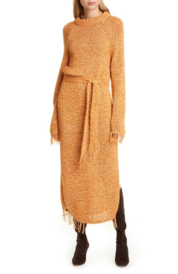 """<p>We're all wrapped up in this <a href=""""https://www.popsugar.com/buy/Nanushka-Kaiza-Belted-Long-Sleeve-Fringe-Sweater-Dress-491460?p_name=Nanushka%20Kaiza%20Belted%20Long%20Sleeve%20Fringe%20Sweater%20Dress&retailer=shop.nordstrom.com&pid=491460&price=455&evar1=fab%3Aus&evar9=45356186&evar98=https%3A%2F%2Fwww.popsugar.com%2Fphoto-gallery%2F45356186%2Fimage%2F46627382%2FNanushka-Kaiza-Belted-Long-Sleeve-Fringe-Sweater-Dress&list1=shopping%2Cfall%20fashion%2Csweaters%2Cdresses%2Cfall&prop13=api&pdata=1"""" rel=""""nofollow"""" data-shoppable-link=""""1"""" target=""""_blank"""" class=""""ga-track"""" data-ga-category=""""Related"""" data-ga-label=""""https://shop.nordstrom.com/s/nanushka-kaiza-belted-long-sleeve-fringe-sweater-dress/5362200?origin=keywordsearch-personalizedsort&amp;breadcrumb=Home%2FAll%20Results&amp;color=orange"""" data-ga-action=""""In-Line Links"""">Nanushka Kaiza Belted Long Sleeve Fringe Sweater Dress</a> ($455).</p>"""
