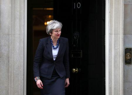 Britain's Prime Minister Theresa May walks out of 10 Downing Street to greet Portugal's Prime Minister Antonio Costa in London