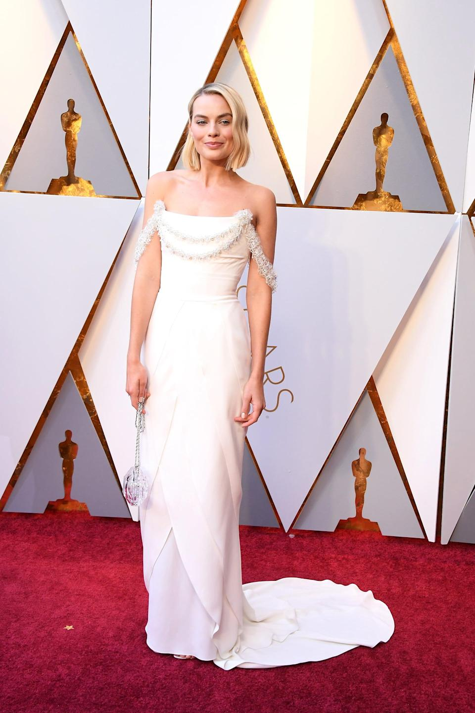 <p>Margot looked angelic in this custom Chanel Haute Couture dress.</p>