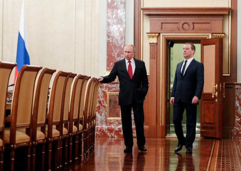 Russian President Vladimir Putin, right, and Russian Prime Minister Dmitry Medvedev talk to each other prior to a cabinet meeting in Moscow, Russia, Wednesday, Jan. 15, 2020. The Tass news agency reports Wednesday that Russian Prime Minister Dmitry Medvedev submitted his resignation to President Vladimir Putin. Russian news agencies said Putin thanked Medvedev for his service but noted that the prime minister's Cabinet failed to fulfill all the objectives set for it. (Dmitry Astakhov, Sputnik, Government Pool Photo via AP)