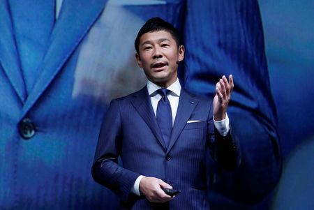FILE PHOTO: Maezawa, the chief executive of Zozo, which operates Japan's popular fashion shopping site Zozotown and is officially called Start Today Co, speaks at an event launching the debut of its formal apparel items, in Tokyo