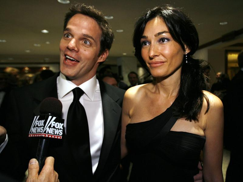 Bill Hemmer and Dora Tomanovich talk with a reporter as they arrive for the White House Correspondents' Association dinner in Washington Saturday, April 26, 2008.