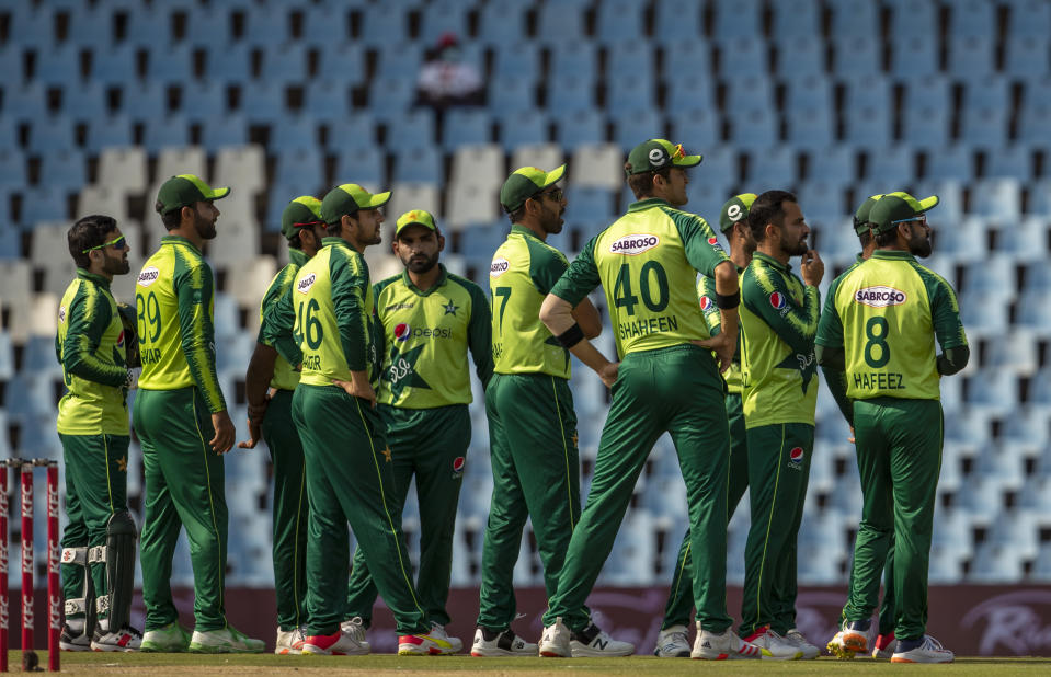 Pakistan players watches the video appeal during the fourth and final T20 cricket match between South Africa and Pakistan at Centurion Park in Pretoria, South Africa, Friday, April 16, 2021. (AP Photo/Themba Hadebe)