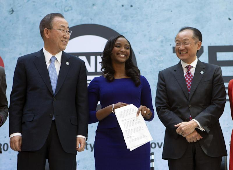 From left, UN Secretary General Ban Ki-moon, CNN International anchor Isha Sesay, and World Bank President Jim Yong Kim attend the forum Endpoverty 2030 during the IMF/World Bank Spring Meetings at IMF headquarters in Washington, Thursday, April 10, 2014. ( AP Photo/Jose Luis Magana)