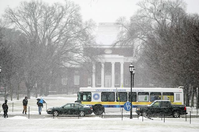 Snow continues to fall on the campus of the University of Delaware Monday, Feb. 3, 2014. (AP Photo/The Wilmington News-Journal, Suchat Pederson) NO SALES