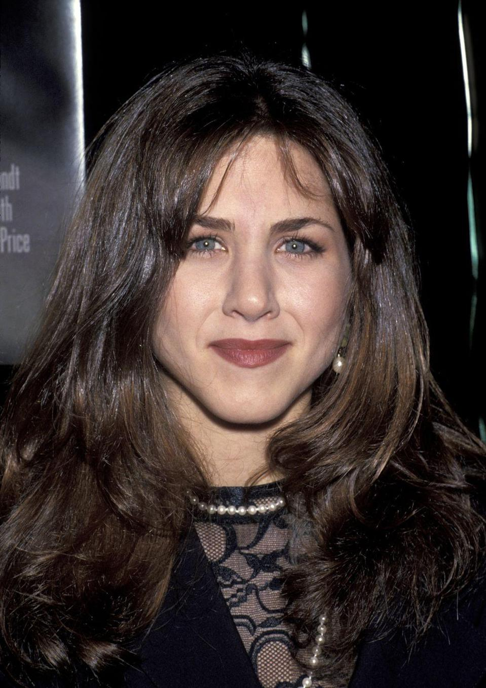 <p>Every good actor has likely starred in a really campy B-horror film. For Jennifer, that was <em>Leprechaun</em>. This photo was snapped in 1992 at the premiere, and the darker tones definitely aid in that scary movie feel.<br></p>