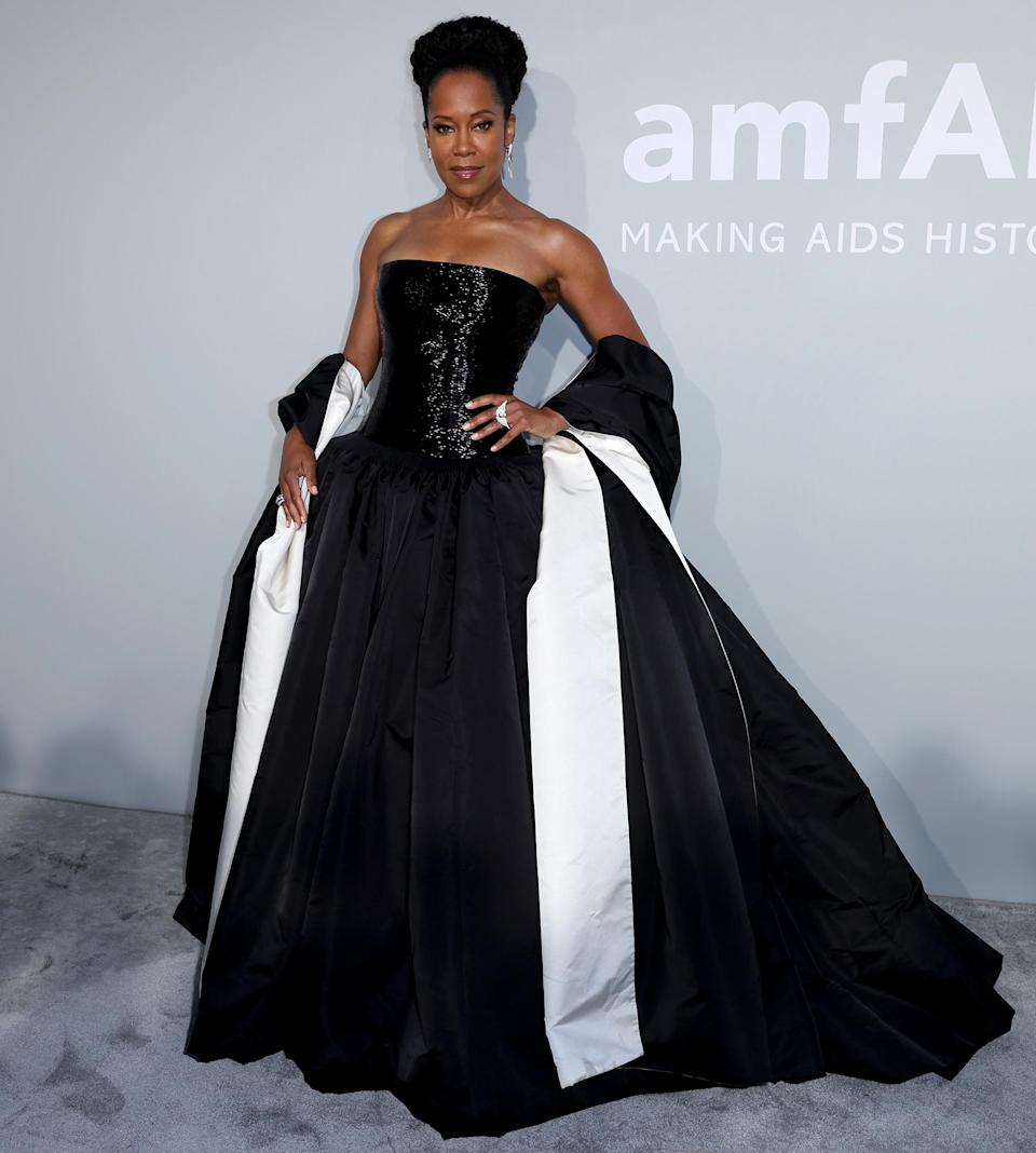 <p>Also at the 2021 amfAR Cannes Gala: Regina King stuns in a gorgeous black-and-white strapless gown.</p>