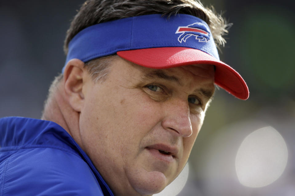 FILE - In this Dec. 21, 2014, file photo, Buffalo Bills head coach Doug Marrone watches as players warm up before an NFL football game against the Oakland Raiders in Oakland, Calif. Marrone has stepped down as coach of the Bills. Bills owner Terry Pegula said Wednesday, Dec. 31 that Marrone exercised the opt-out clause in his contract. (AP Photo/Marcio Jose Sanchez, File)