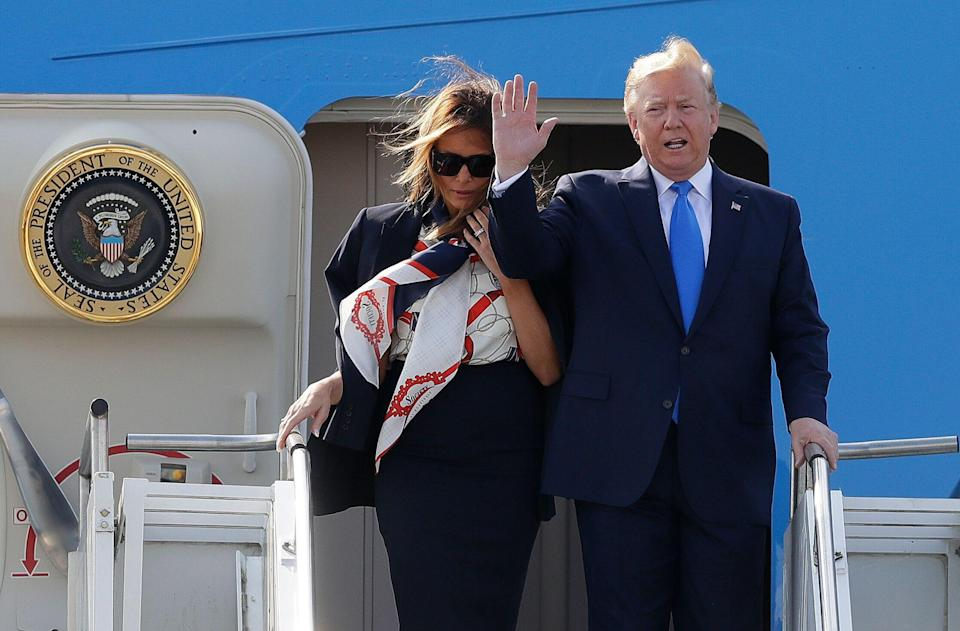 President Trump waves as he and first lady Melania Trump arrive at Stansted Airport in England on Monday. (Photo: Kirsty Wigglesworth/AP)