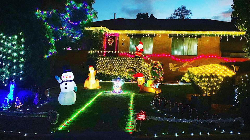 The Carter family home lit up with Christmas decorations in Canberra