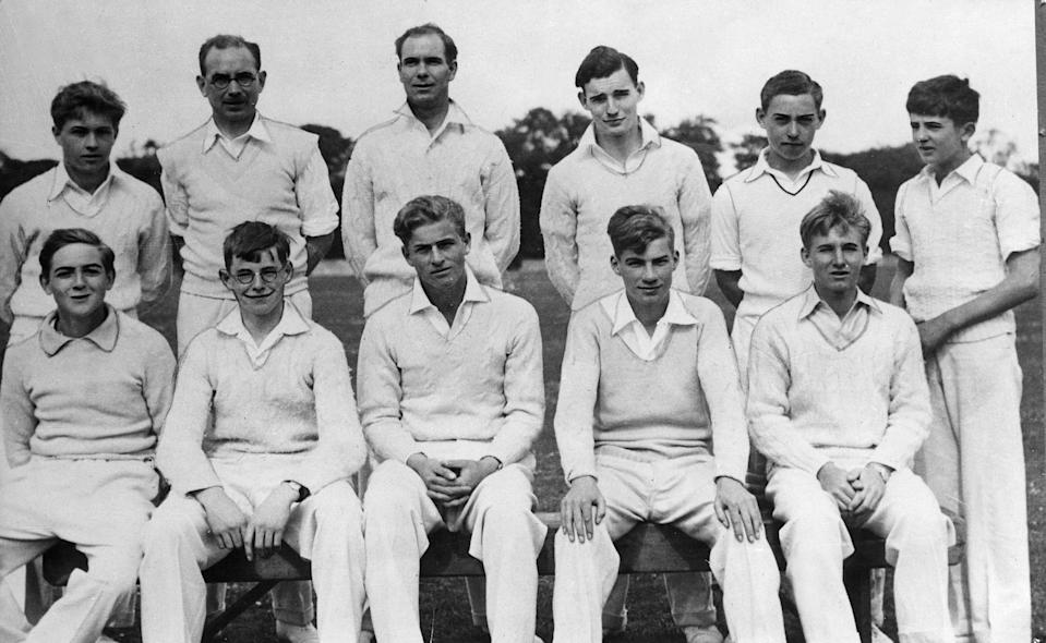 <p>A teenaged Philip (bottom row, centre) donned crisp cricket whites for a team photo at school in Scotland in 1938. Photo: Getty Images.</p>