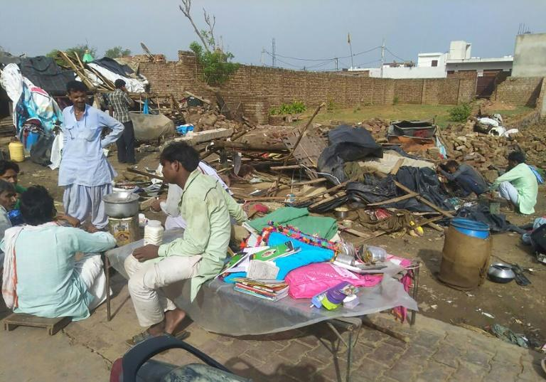 The storm flattened homes and toppled electricity pylons in Rajasthan
