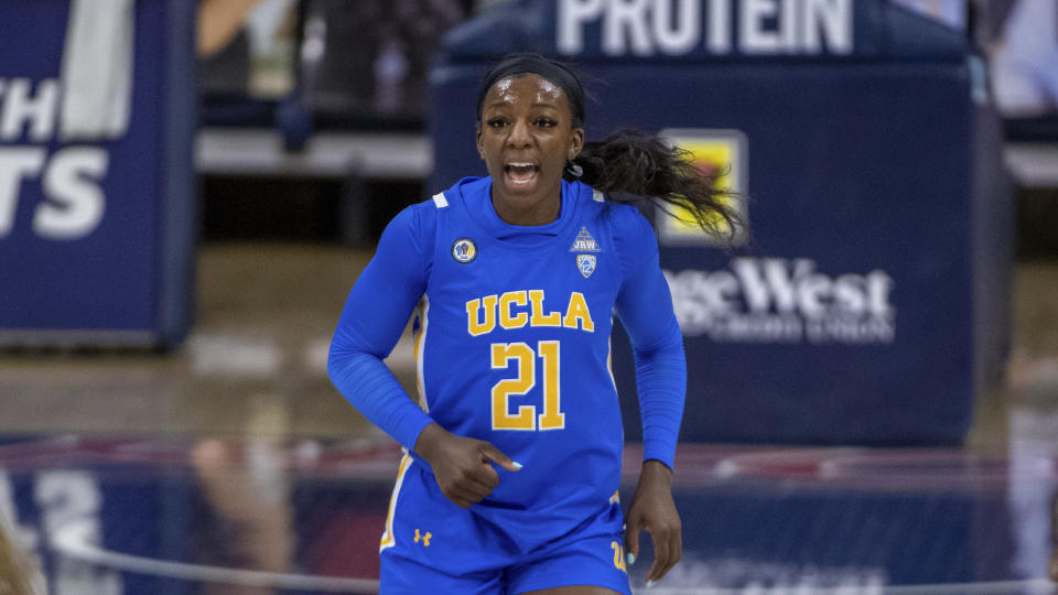 UCLA Bruins forward Michaela Onyenwere (21) shouts on the court against the Arizona Wildcats during an NCAA basketball game on Friday, Dec. 4, 2020 in Tucson, Ariz. (AP Photo/Jennifer Stewart)