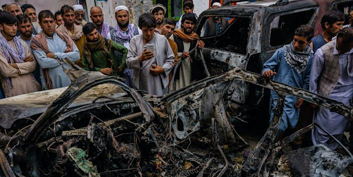 Afghans view aftermath of a US drone strike