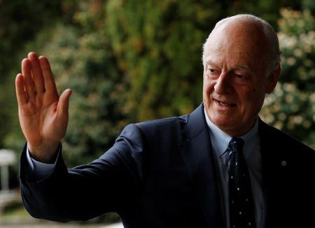 UN Special Envoy for Syria de Mistura waves to the press prior a round of negotiations of the Intra Syria talks at the UN in Geneva
