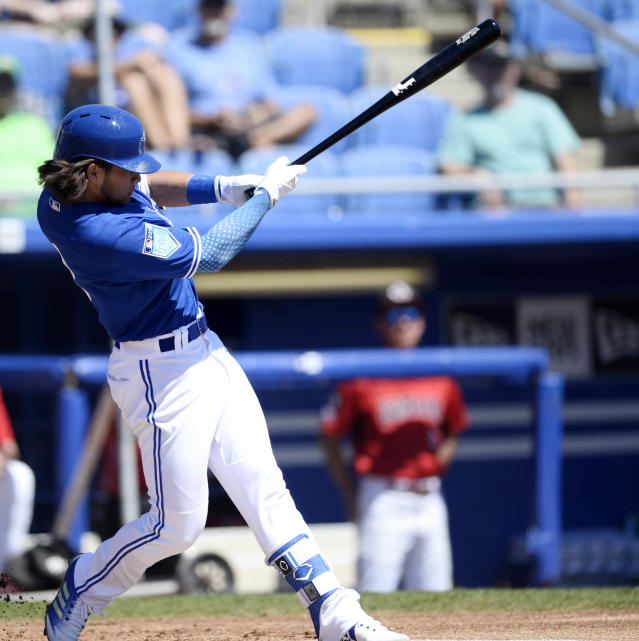 Toronto Blue Jays Bo Bichette (3) hits a two-run home run during the first inning of a spring training baseball game against the Canada Junior National Team Saturday, March 17, 2018, in Dunedin, Fla. (AP Photo/Jason Behnken)