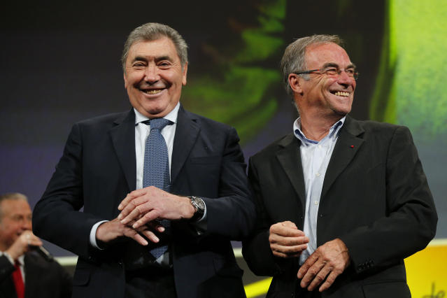 Five-time Tour de France winners Eddy Merckx, from Belgium, left, and Bernard Hinault from France attend the presentation of the 2019 Tour de France cycling race, in Paris, Thursday Oct. 25, 2018. The 106th edition of the race starts on July 6 2019 to end on the Champs-Elysees avenue on July 28.(AP Photo/Thibault Camus)