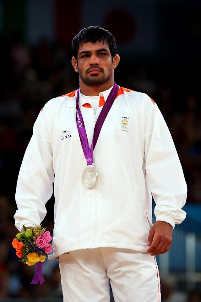 LONDON, ENGLAND - AUGUST 12: Silver medallist Sushil Kumar of India celebrates with his medal during the medal ceremony following the Men's Freestyle 66 kg Wrestling gold medal fight on Day 16 of the London 2012 Olympic Games at ExCeL on August 12, 2012 in London, England.  (Photo by Ryan Pierse/Getty Images)