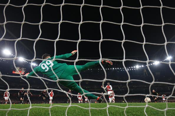 Milan's Gianluigi Donnarumma is sent the wrong way by Arsenal's Danny Welbeck.