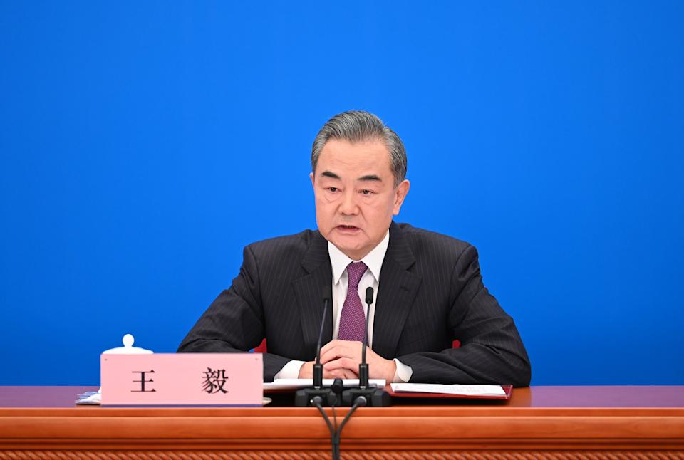 Chinese State Councilor and Foreign Minister Wang Yi speaks at a press conference.