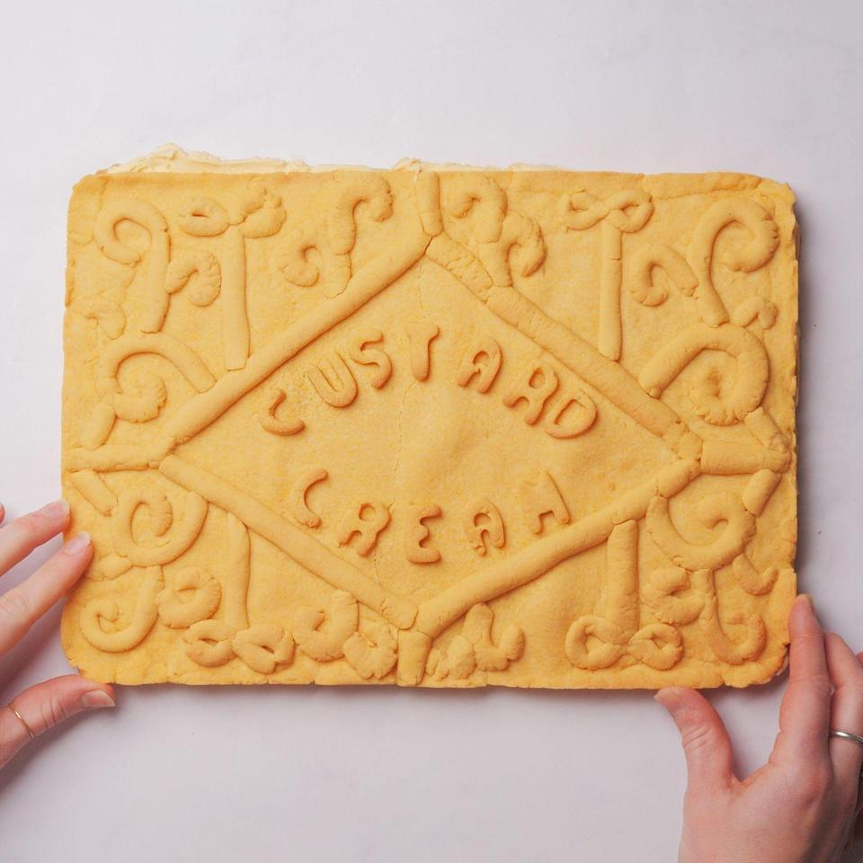 """<p>This British classic has been made into a giant biscuit that will feed plenty. Perfect for a show-stopper at a bake sale or an alternative to a children's birthday cake!</p><p><strong>Recipe: <a href=""""https://www.goodhousekeeping.com/uk/food/recipes/a29812422/giant-custard-cream/"""" rel=""""nofollow noopener"""" target=""""_blank"""" data-ylk=""""slk:Giant Custard Cream"""" class=""""link rapid-noclick-resp"""">Giant Custard Cream</a></strong></p>"""