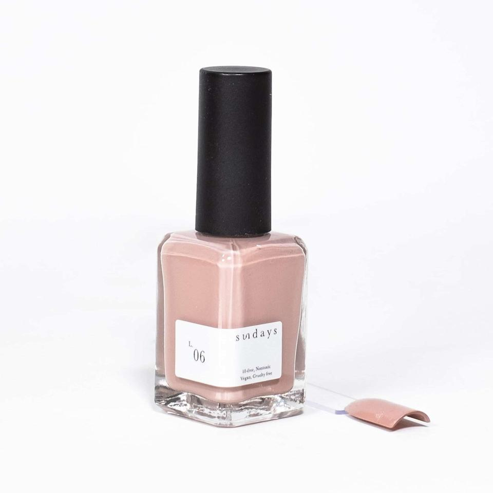 """We don't know how they did it, but Sundays seems to have reinvented <a href=""""https://www.allure.com/gallery/nude-nail-polish-shades-for-every-skin-tone?mbid=synd_yahoo_rss"""" rel=""""nofollow noopener"""" target=""""_blank"""" data-ylk=""""slk:nude nail polish"""" class=""""link rapid-noclick-resp"""">nude nail polish</a> to make it <em>actually interesting</em>. Something about the blend of warm and cool undertones in the glossy, opaque shade, known simply as L.06, makes it gorgeous on any skin tone, and the barely-there sparkle keeps it from falling flat. It's a true year-round must-wear."""