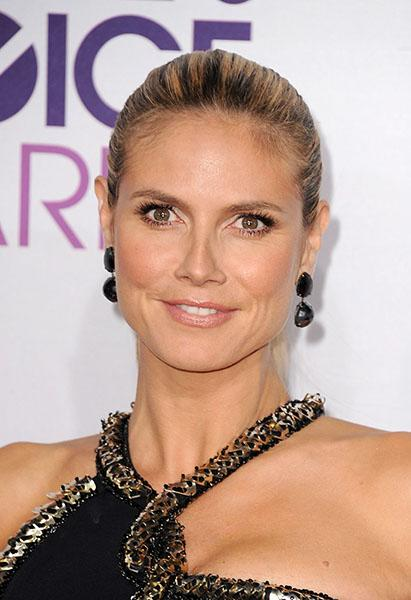 Heidi Klum wearing faceted black Lorraine Schwartz jewels - Black earrings can be a little goth, or a bit….teenager at the mall. Not on Heidi, however. Thirty-five carats of faceted double black diamonds are decidedly sophisticated, with all the right edge.